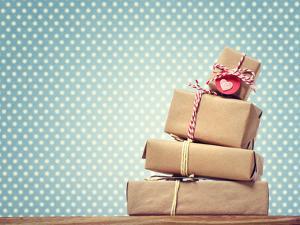 Handmade Gift Boxes over Polka Dots Background by Melpomene