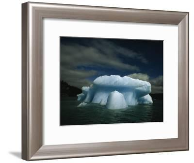 Melting Iceberg under a Cloud Filled Sky-Paul Chesley-Framed Photographic Print