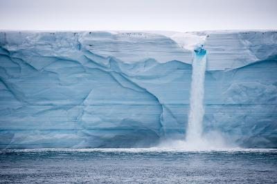 Meltwater Pours over an Ice Cliff from the Surface of the Nordaustlandet Ice Cap-Michael Melford-Photographic Print