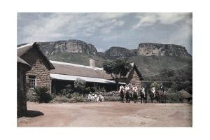 A Group of People Horseback Ride Through Natal Drakensberg Park by Melville Chater