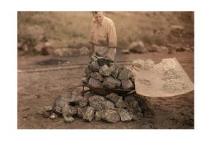 A Man Examines the Mineral Yielded from South Africa's Rocks by Melville Chater