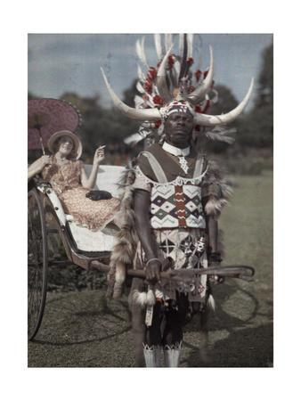 A Zulu Tribesman Pulls His Female Employer around in a Cart