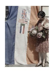 Miss Cape Town Stands with the Union Banner and National Flowers by Melville Chater