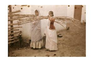 Two Young Indian Girls Carry Sugar Cane by Melville Chater