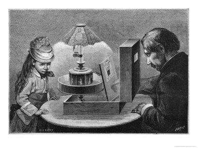 Young Girl is Fascinated by the Illusion of Movement Given by Reynaud's Praxinoscope