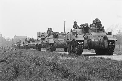 Members of the British 49th Armoured Personnel Carrier Regiment Riding Along a Line of Tanks-George Silk-Photographic Print
