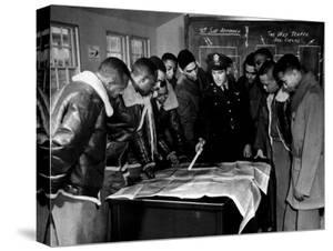 Members of the Famed Tuskegee Airmen Looking at a Flight Map During a Training Class