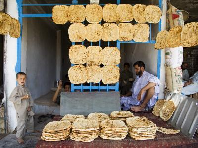 Men and Boys at Traditional Afghan Bakery-Tony Wheeler-Photographic Print