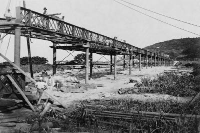 Men Build a Railway Bridge--Photographic Print