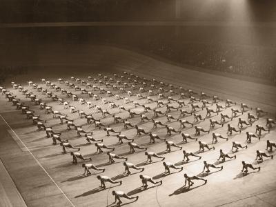 Men Doing Gymnastics in Unison in Hall--Photographic Print