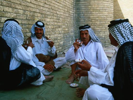 Maula Ali Shrine Wallpaper: Men Drinking Tea Outside The Holy Shrine Of The Imam Ali