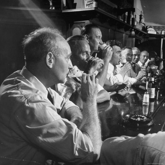 Men Gathered Around For Their Weekly Meeting Indulging in Glasses of Beer-Frank Scherschel-Photographic Print