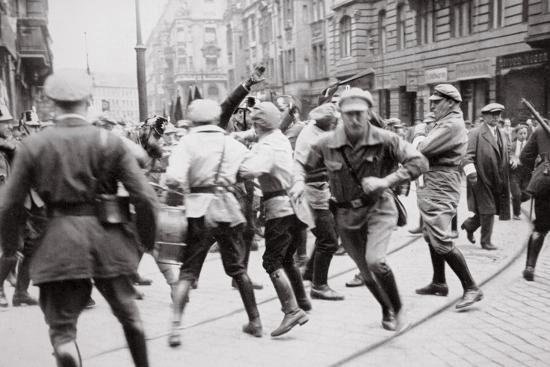 Men in Bolshevik uniform fighting police in the street, Germany, c1918-c1933(?) (1936)-Unknown-Photographic Print