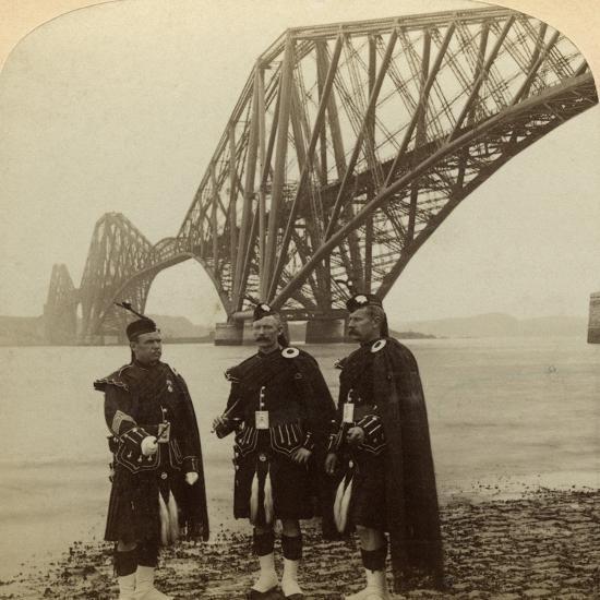 Men in Highland Dress in Front of the Forth Bridge, Scotland-Underwood & Underwood-Photographic Print