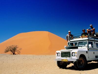 Men on Four Wheel Drive Vehicle at Dune 45 in Namib Nauklaft National Park, Sossusvlei, Namibia-Christer Fredriksson-Photographic Print