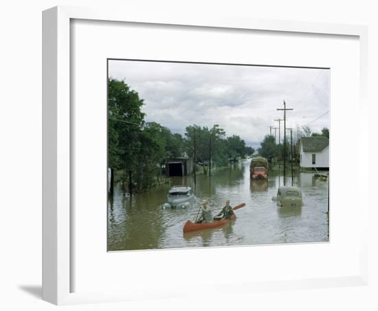 Men Paddle Canoe Down Street Submerged by Flash Flood in May 1951-Jack Fletcher-Framed Photographic Print
