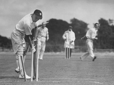 Men Setting Up Cricket Field--Photographic Print