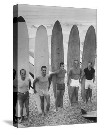 Men Surfing at Waikiki Club