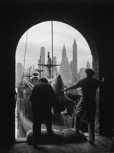 Men Unloading Coffee at Brooklyn Dock. View of Downtown Manhattan in Background-Andreas Feininger-Photographic Print