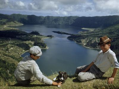 Men with Puppy Overlook Hourglass-Shaped Lakes in Volcanic Crater-Robert Sisson-Photographic Print