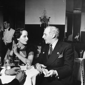 Merle Oberon and Walter Winchell Chatting at the Stork Club