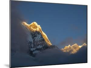 Asia, Nepal, Annapurna Base Camp. Annapurna South peak at sunrise with clouds below. by Merrill Images