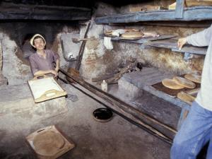 Baking Bread in a Wood-Fired Oven, Morocco by Merrill Images