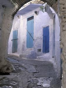 Blue Doors and Whitewashed Wall, Morocco by Merrill Images