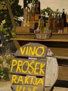 Bottles of local wine on display, Stari Grad Town, Hvar Island, Dalmatia, Croatia by Merrill Images