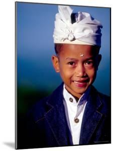 Boy in Formal Dress at Hindu Temple Ceremony, Indonesia by Merrill Images