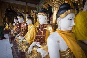 Buddhas at Shwedagon Pagoda in Yangon, Myanmar (Burma) by Merrill Images