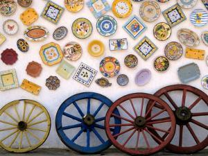 Ceramic Plates and Wagon Wheels, Algarve, Portugal by Merrill Images