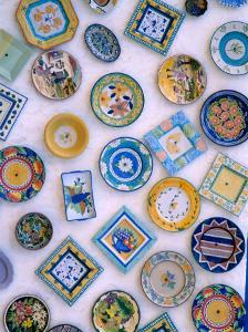 Ceramic Plates on Shop Wall, Algarve, Portugal by Merrill Images