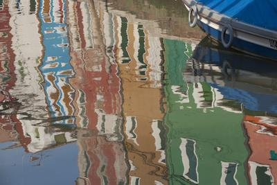 Italy, Burano, reflection of colorful houses in canal.
