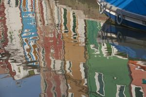 Italy, Burano, reflection of colorful houses in canal. by Merrill Images