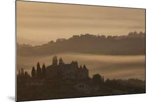 Italy, Tuscany, San Gimignano, farmhouses on ridges with fog at dawn. by Merrill Images