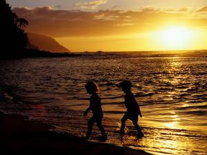 Kids on Beach at Sunset, Hawaii, USA by Merrill Images