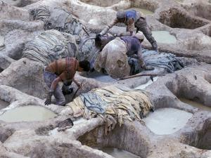 Men Working Tannery Vats in the Medina, Fes, Morocco by Merrill Images