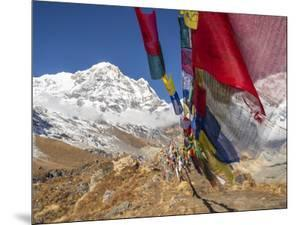 Nepal, Annapurna Conservation Area, Annapurna Base Camp, Annapurna South with prayer flags. by Merrill Images