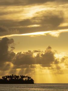 Panama, Golfo de San Blas. Guna Yala Autonomous Region, island with palm trees at sunset. by Merrill Images