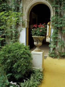 Planter and Arched Entrance to Garden in Casa de Pilatos Palace, Sevilla, Spain by Merrill Images