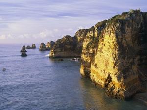 Sanstone Cliffs at Praia de Dona Ana Beach in Portugal by Merrill Images
