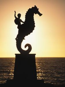Statue of Boy Riding Seahorse, Bay of Banderas, Puerto Vallarta, Mexico by Merrill Images