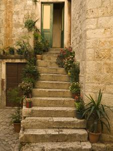Steps with plants outside historic stone house, Trogir, Dalamatia, Croatia by Merrill Images