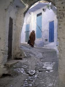 Traditionally Dressed Woman along Cobblestone Alley, Morocco by Merrill Images