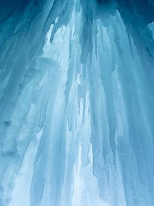 Usa, Montana, Big Sky. Ousel Falls, icicles in cave. by Merrill Images