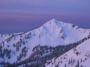 Usa, Washington State, Crystal Mountain. 'The King' summit and snow-filled bowls at sunset. by Merrill Images