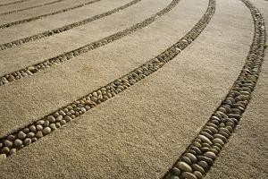 Usa, Washington State. Paths and stone dividers in labyrinth used for walking meditation./n by Merrill Images