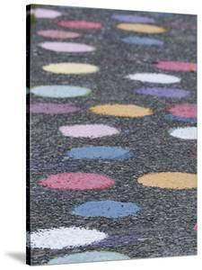 USA, Washington State, Seattle. Multi-colored dots painted on a street. by Merrill Images