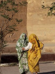 Veiled Muslim Women Talking at Base of City Walls, Morocco by Merrill Images
